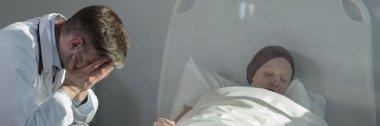 Broken medic and sleeping child