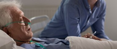Aged man in hospital bed