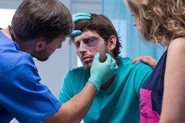 Beaten man with black eye
