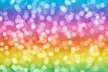 Rainbow colorful background with natural bokeh defocused sparkling lights. Bright and vivid texture with twinkling lights