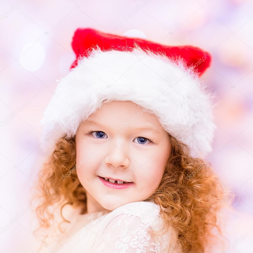 8da289cf6 Closeup portrait of a beautiful red-haired little girl with long ...