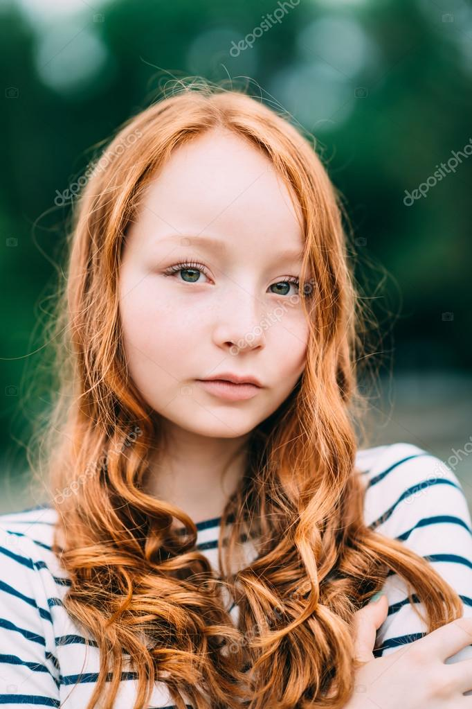 young girl with red hair stock photo image of forest an adorable smiling young woman with green eyes and long
