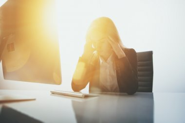 Photo of businesswoman in stress.