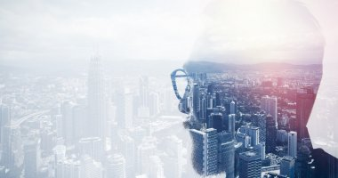 Closeup photo of stylish bearded banker wearing glasses and looking city. Double exposure, panoramic view contemporary megalopolis background. Space for your business message. Wide