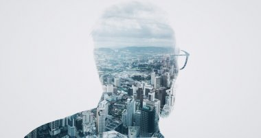 Photo of stylish bearded banker wearing trendy suit and looking city. Double exposure, panoramic view contemporary megalopolis background. Space for your business message.  Isolated white. Wide