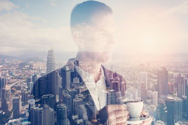 Photo of stylish adult businessman wearing trendy suit and holding cup coffee. Double exposure, panoramic view contemporary city sunset. Horizontal