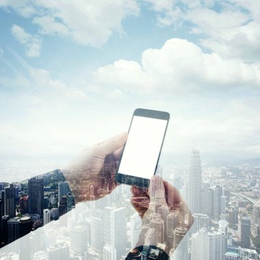 Double exposure photo businessman holding modern smartphone hands. Panoramic view contemporary city and clouds background. White blank screen ready for your business information. Square mockup.