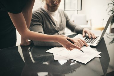 Business situation, signs contracts. Account manager working modern office with new business project. Using laptop, discussion startup, colsultation colleague.Horizontal.Blurred background,film effect