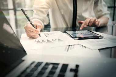 Analytical department working process.Closeup photo business woman showing reports modern tablet screen.Statistics graphics screen.Banker holding pen for signs documents, new startup. Horizontal