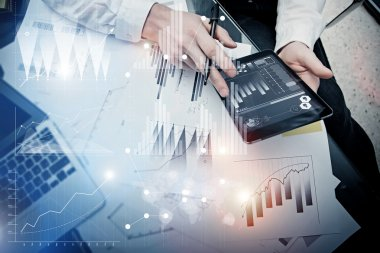 Investment banker working process.Picture trader work market report modern tablet.Use electronic device.Graphic icons,stock exchange reports interfaces.Business project startup.Horizontal,film effect