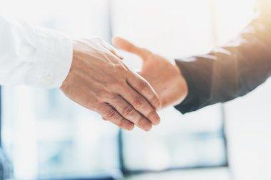 Business partnership meeting. Photo businessmans handshake. Successful businessmen handshaking after good deal. Horizontal, blurred background