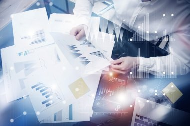 Risk management work process.Photo banker holding statistics document hands.Using electronic devices.Graphic icons,stock exchange reports screen interfaces.Business startup.Flares effect