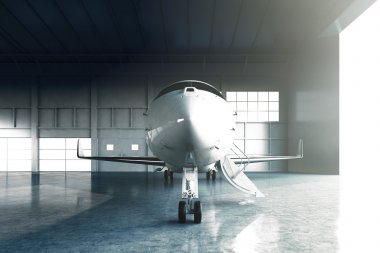 Photo of White Glossy Luxury Generic Design Private Jet parking in hangar airport. Concrete floor. Business Travel Picture. Horizontal, front view. Film Effect. 3D rendering.