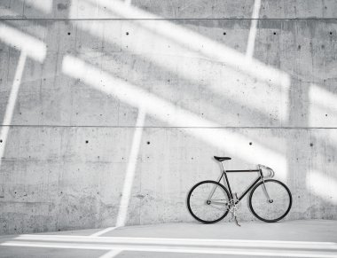 Horizontal Photo Blank Grungy Smooth Bare Concrete Wall in Modern Loft Studio with Classic bike. Soft Sunrays Reflecting on Surface. Empty Abstract background.