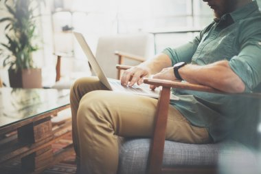 Bearded Businessman working Laptop modern Interior Design Loft Studio.Man sitting Vintage chair.Use contemporary Notebook, blurred background.Creative Process New Startup Idea.Horizontal,film effect.