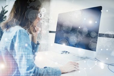 Woman Working Modern Desktop Monitor Hand Use Mouse.Account Manager Researching Process.Business Team New Startup Loft Office.HiTech Digital Diagrams Interfaces Effect.Analyze market stock.Blurred.