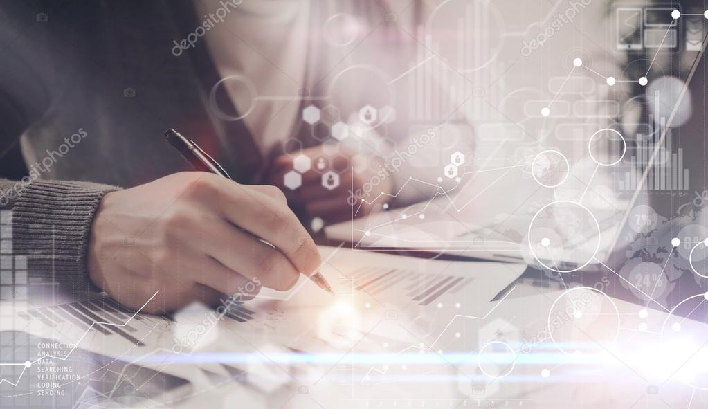 Man Making Notes Pen Table.Project Manager Researching Process.Business Team Working Startup modern Office.Global Strategy Virtual Icon.Innovation Graphs Interfaces.Analyze market stock Blurred