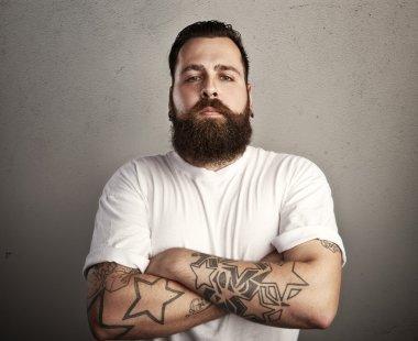 Brutal bearded man wearing  t-shirt