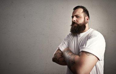Bearded man wearing white t-shirt