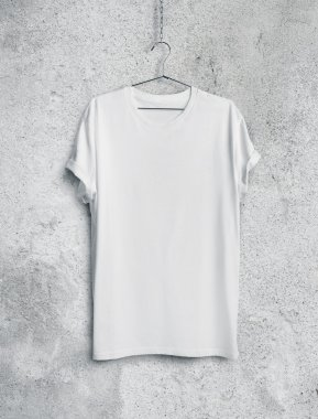 White t-shirt on concrete wall