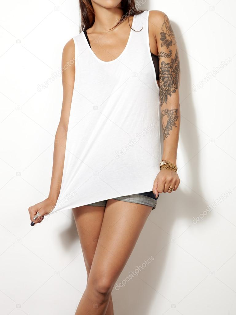 Woman wearing sleeveless t-shirt