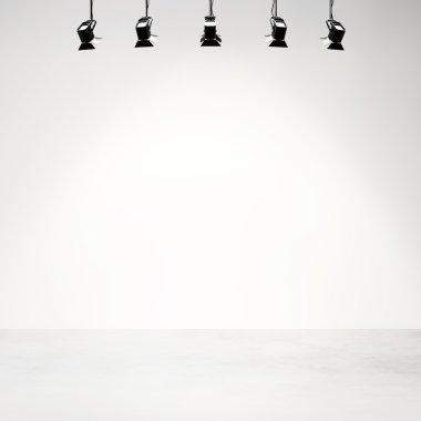 White studio background with spotlights