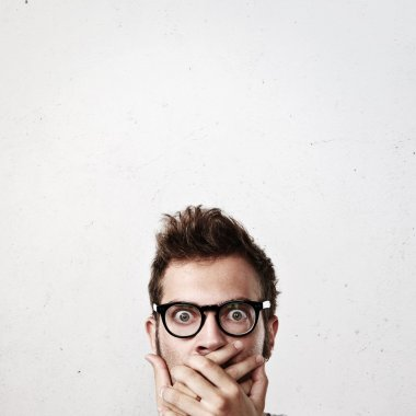 Surprised young man wearing eyeglasses