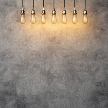 Decorative vintage lightbulbs with concrete background