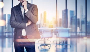 Businessman on blurred office background