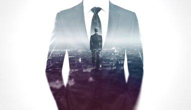 Businessman silhouette over city