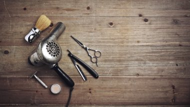 Vintage barber equipment on wood desk