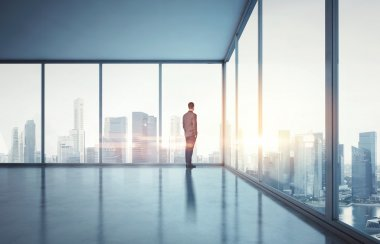 Businessman in suit looking at sunrise
