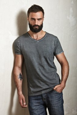 Bearded man wearing grey t-shirt