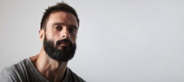 bearded man looking at camera