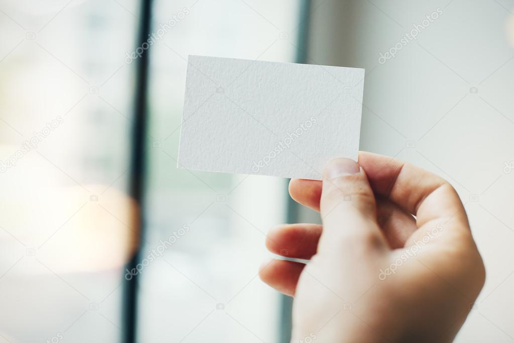 Hand holding business card — Stock Photo © kantver #82835794