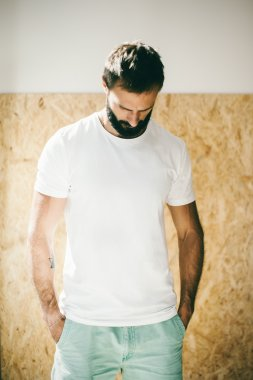 Mockup of a bearded man wearing white tshirt and green shorts