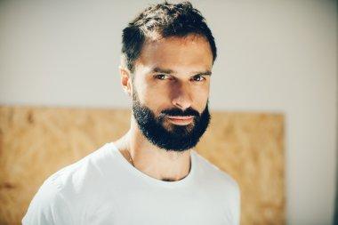 Portrait of a cute man wearing white tshirt