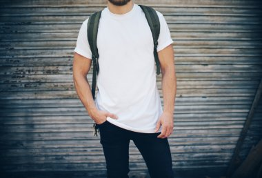 Bearded man wearing white blank t-shirt