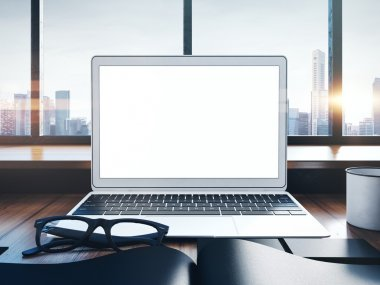 Photo of generic laptop on a workspace