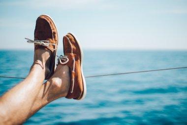 Photo of man legs on the yacht