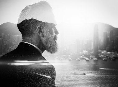 Stylish businessman in a suit looking at the horizon. Photo of double exposure of the city. black and white stock vector