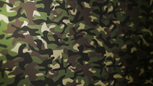 Zöld álcázási minta háttér. Katonai egyenruha koncepció. Absztrakt vonal és hullámstruktúra. Hurokanimáció.