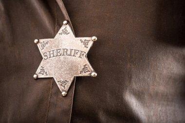 Close up of sheriff badge