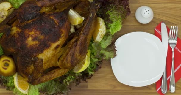 roasted chicken with tangerines and herbs on a plate