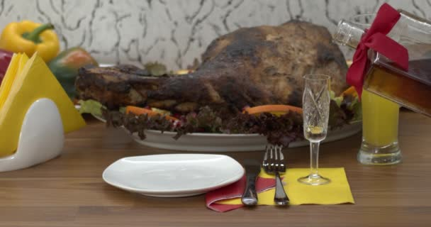 Meat products on a white plates, natural food. Various delicious foods on a wooden table.