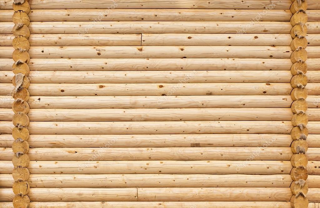 Parete della casa di tronchi di legno tondi foto stock for Grandi piani di casa di tronchi