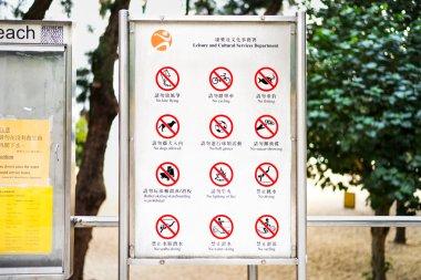 Repulse Bay, Hongkong - November 19, 2015: Twelve warning chinese signs