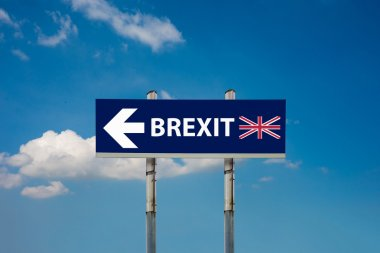a road signs EU and BREXIT and a blue sky