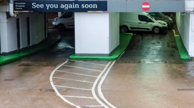 Chester; UK: Jan 29, 2021: The entrance and exit to the Grosvenor Shopping Centre car park displays a sign saying see you again soon. The shopping centre is currentlly closed due to the lockdown
