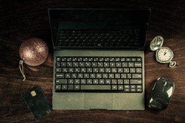 black laptop on wood
